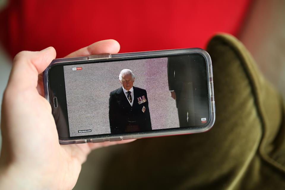 <p>A person watches a live stream of the duke's funeral on a mobile phone in Tipperary, Ireland. (Getty)</p>