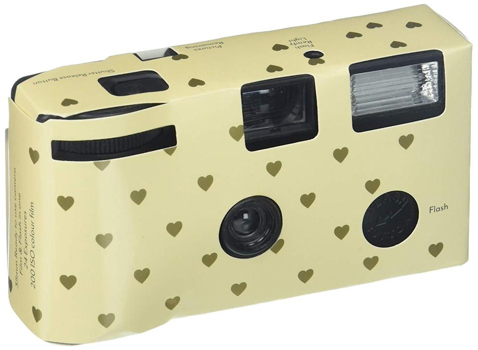 """Never underestimate how exciting it is to get film developed after forgetting about it for three months. <br><br><strong>Weddingstar Inc.</strong> Single Use Camera, $, available at <a href=""""https://www.amazon.com/Single-Use-Camera-Hearts-Design/dp/B00BTN9S8W/"""" rel=""""nofollow noopener"""" target=""""_blank"""" data-ylk=""""slk:Amazon"""" class=""""link rapid-noclick-resp"""">Amazon</a>"""