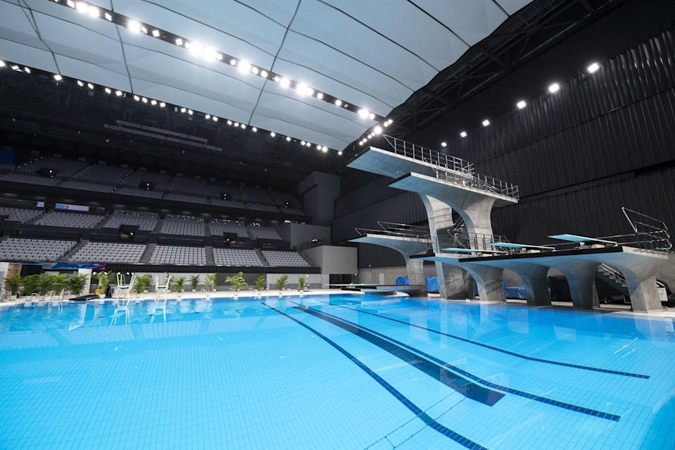 This picture shows a general view of the diving pool at the Tokyo Aquatics Centre - the venue for swimming, diving and artistic swimming at the 2020 Tokyo Olympics and Paralympics Games - during a training session for the Japan Swimming Championships competition in Tokyo on April 6, 2021. (Photo by CHARLY TRIBALLEAU / AFP) (Photo by CHARLY TRIBALLEAU/AFP via Getty Images)