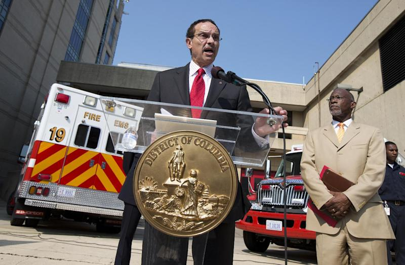 District of Columbia Mayor Vincent Gray, with Deputy Mayor for Public Safety and Justice Paul Quander, right, announces the new Fire and Emergency Medical Services hires and display the District's newest ambulances during a news conference in Washington, Tuesday, Aug. 27, 2013. (AP Photo/Manuel Balce Ceneta)