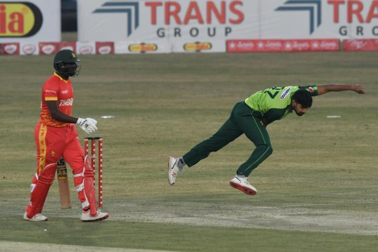 Pakistan's Haris Rauf unleashes a delivery against Zimbabwe during their second Twenty20 match in Rawalpindi. Donald Tiripano is the backing-up Zimbabwe batsman