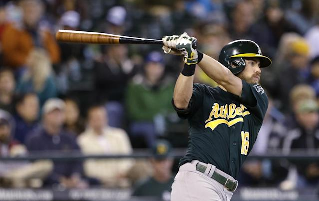 Oakland Athletics' Josh Reddick doubles in a run against the Seattle Mariners in the fifth inning of a baseball game on Sunday, Sept. 29, 2013, in Seattle. (AP Photo/Elaine Thompson)