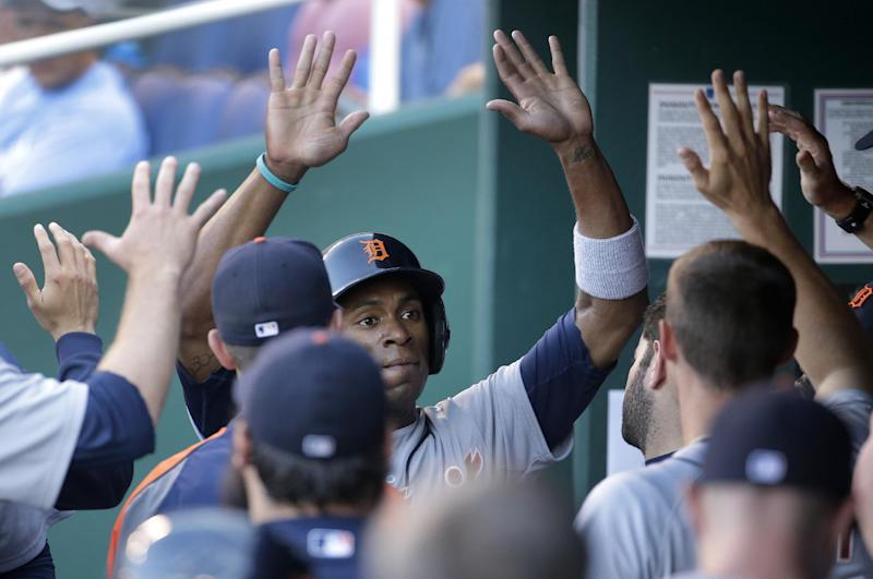Detroit Tigers' Austin Jackson celebrates in the dugout after scoring on a ground out by Miguel Cabrera during the first inning of a baseball game against the Kansas City Royals Thursday, July 10, 2014, in Kansas City, Mo. (AP Photo/Charlie Riedel)