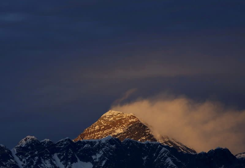 FILE PHOTO: Light illuminates Mount Everest, during sunset in Solukhumbu District also known as the Everest region