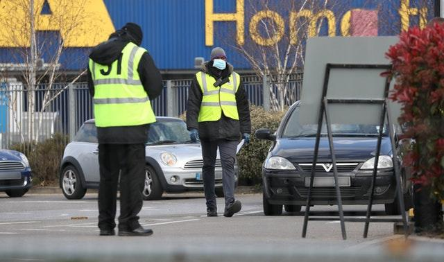 Stewards organise traffic at a Covid-19 test centre for NHS workers which has opened at Ikea in Wembley, north-west London (Jonathan Brady/PA)