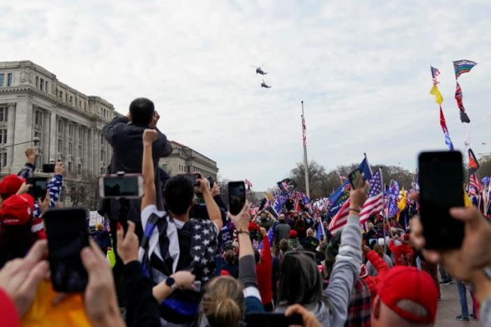 """Marine One, carrying U.S. President Donald Trump, passes over the """"Stop the Steal"""" rally, in Washington"""