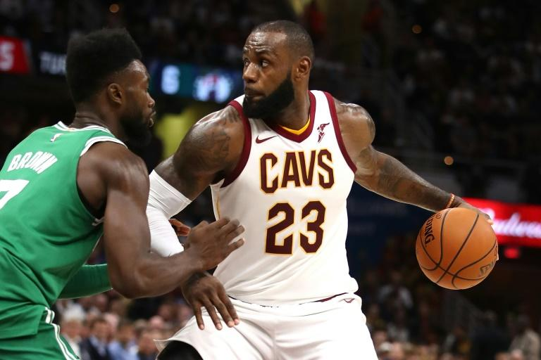 LeBron James of the Cleveland Cavaliers looks to get past Jaylen Brown of the Boston Celtics during the first half, at Quicken Loans Arena in Cleveland, Ohio, on October 17, 2017
