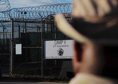 """The outside of the """"Camp Five"""" detention facility is seen at U.S. Naval Station Guantanamo Bay December 10, 2008 in this pool image reviewed by the U.S. military. REUTERS/Mandel Ngan/Pool/File Photo"""