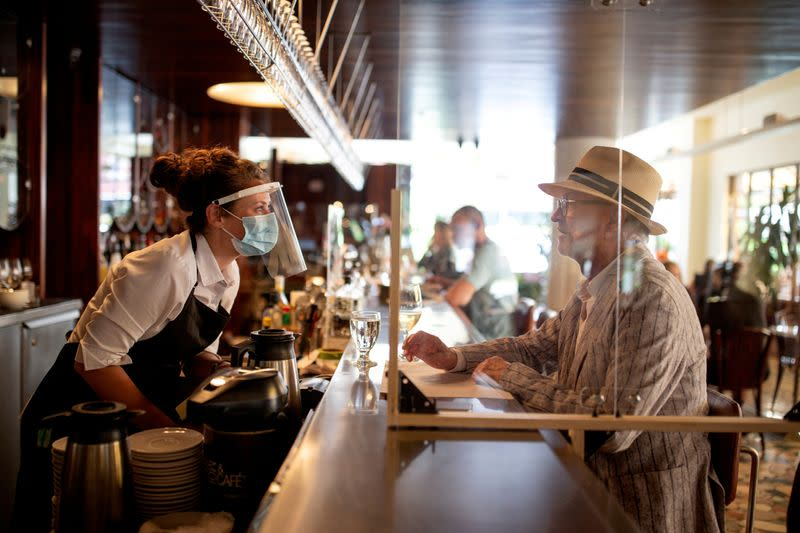 FILE PHOTO: Patrons return to restaurants as coronavirus restrictions lifted to visit restaurants in Montreal