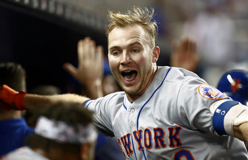 New York Mets' Pete Alonso celebrates after hitting a three-run home run during the ninth inning of a baseball game against the Miami Marlins, Monday, April 1, 2019, in Miami. It was Alonso's first major league home run. (AP Photo/Brynn Anderson)