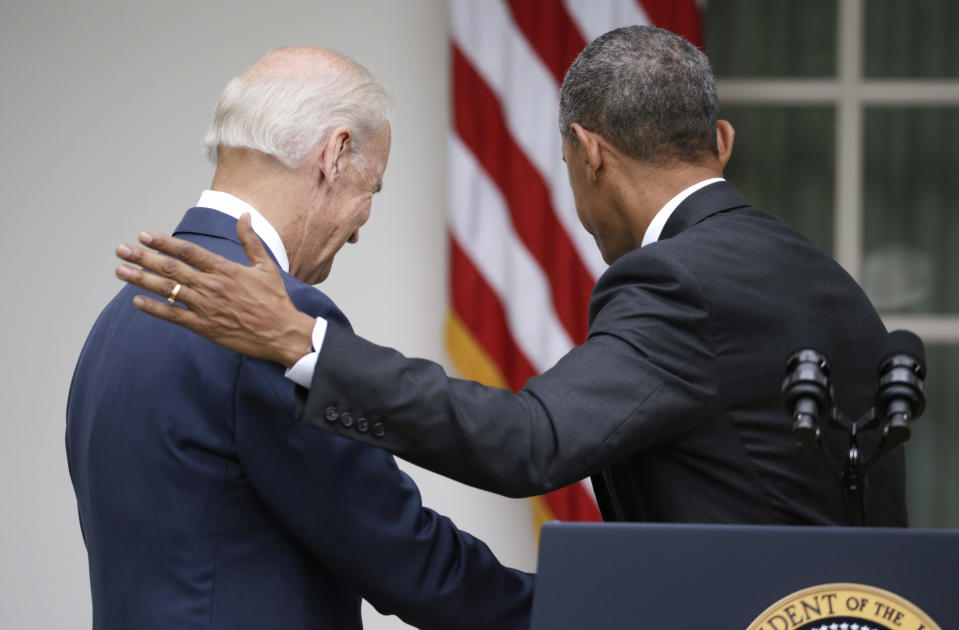 U.S. President Barack Obama (R) and Vice President Joe Biden walk back to the Oval Office after speaking about the Supreme Court ruling to uphold the nationwide availability of tax subsidies that are crucial to the implementation of the Affordable Care Act, at the White House in Washington June 25, 2015.  REUTERS/Gary Cameron