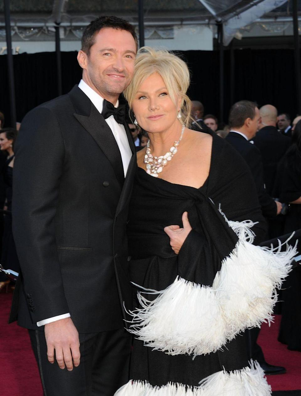 """<p><strong>Age gap: </strong>13 years</p><p><a href=""""https://www.goodhousekeeping.com/life/relationships/news/a47389/hugh-jackman-wife-deborra-lee-furness/"""" rel=""""nofollow noopener"""" target=""""_blank"""" data-ylk=""""slk:Hugh met Deborra-Lee"""" class=""""link rapid-noclick-resp"""">Hugh met Deborra-Lee</a> on the set of an Australian television show called <em>Correlli</em> in 1995 and almost instantly knew he would marry her. After both admitted they had crushes on one another, they started dating, and a year later they made it official.</p>"""