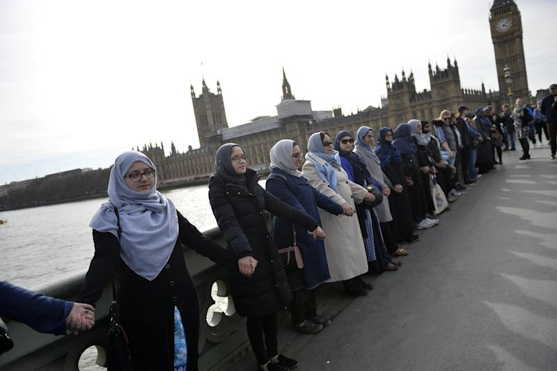 Tribute: Members of the 'Women's March' rally on Westminster Bridge: EPA