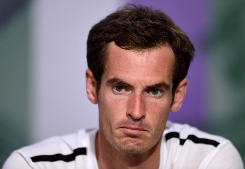 Andy Murray of Britain attends a news conference after being defeated by Grigor Dimitrov of Bulgaria in their men's singles quarter-final tennis match at the Wimbledon Tennis Championships, in London