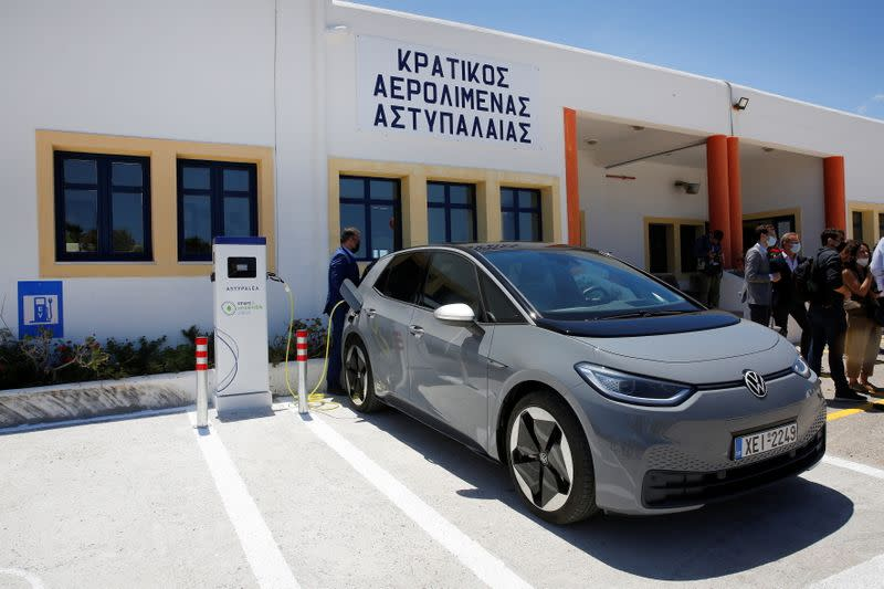 Charging a Volkswagen ID.4 electric car at the airport on the island of Astypalea