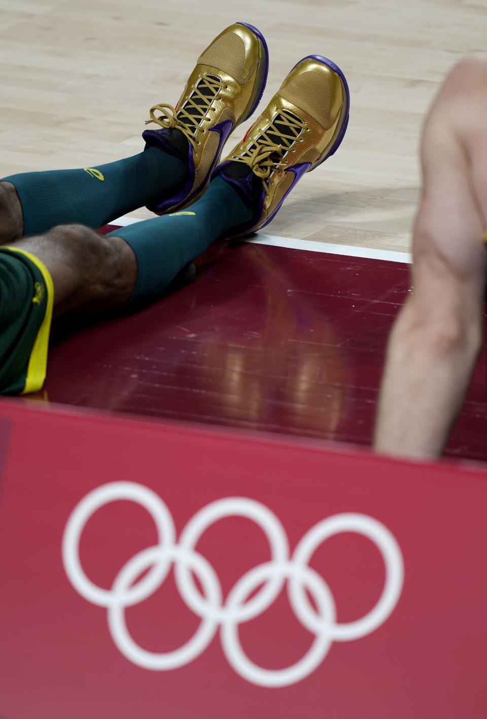 Australia' Matisse Thybulle wears gold shoes during practices with the team at the 2020 Summer Olympics, Friday, July 23, 2021, in Saitama, Japan. (AP Photo/Eric Gay) - Credit: AP