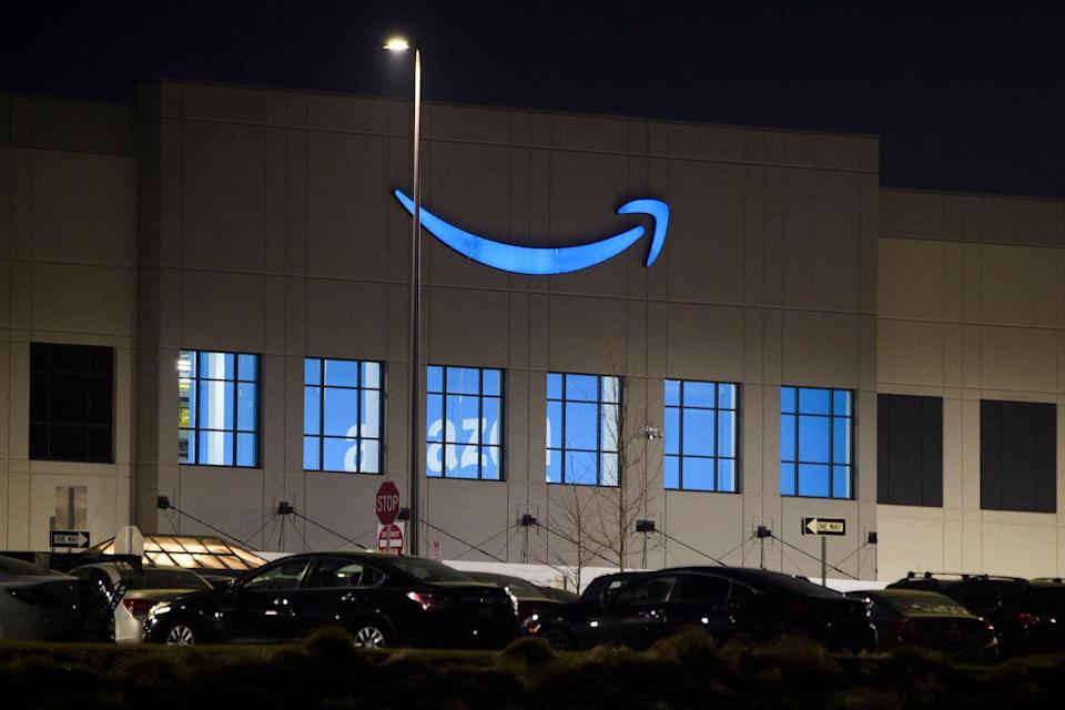 An Amazon  fulfillment center early on March 27, 2021 in Bessemer, Alabama. - Amazon Alabama workers are trying to unionize with the Retail, Wholesale and Department Store Union (RWDSU) in Birmingham, as clashes intensified between lawmakers and the e-commerce giant ahead of a deadline for a vote that could lead to the first union on US soil at the massive tech company. The visit marks the latest high-profile appearance in the contentious organizing effort for some 5,800 employees at Amazon's warehouse in Bessemer which culminates next week. (Photo by Patrick T. FALLON / AFP) (Photo by PATRICK T. FALLON/AFP via Getty Images)