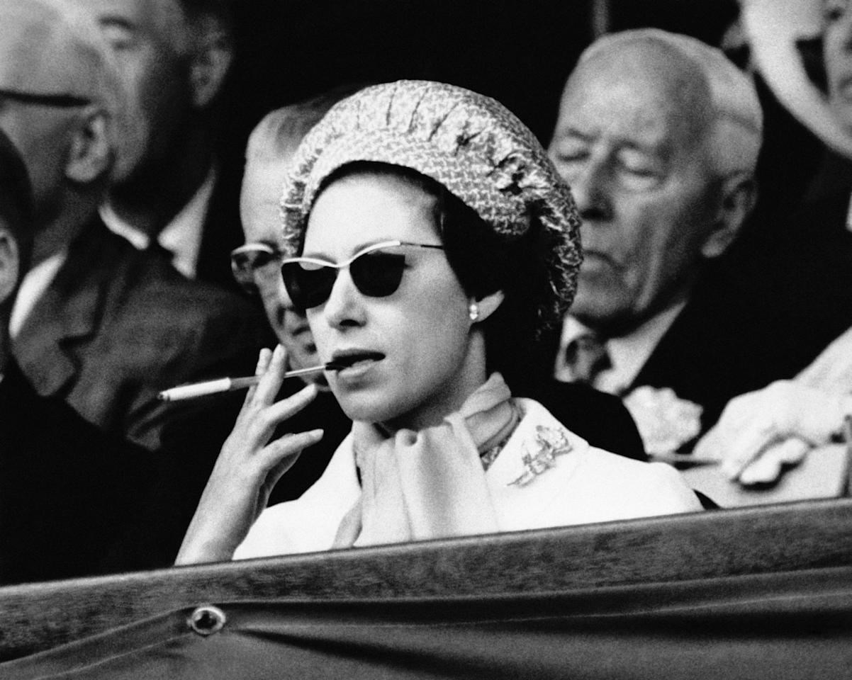 <p>Back in 1956, Princess Margaret proved that she's the real Queen of the game, as she smoked a cigarette in the royal box watching the Wimbledon Men's Finals. We knew she was our favourite character in 'The Crown' for a reason… <em>[Photo: Getty]</em> </p>