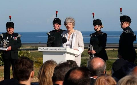 Theresa May delivering her speech - Credit: Reuters