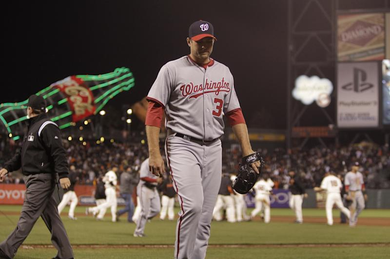 Washington Nationals' Craig Stammen walks off the field after giving up the game winning hit to San Francisco Giants' Freddy Sanchez during the 13th inning of a baseball game Monday, June 6, 2011, in San Francisco. (AP Photo/Ben Margot)
