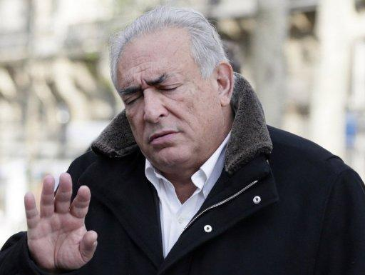<p>Former International Monetary Fund chief Dominique Strauss-Kahn gestures as he leaves a restaurant in Paris on December 11, 2012. A probe into allegations that Strauss-Kahn procured prostitutes for sex parties will continue after a French court rejected a request for pimping charges against the former IMF chief to be dismissed.</p>