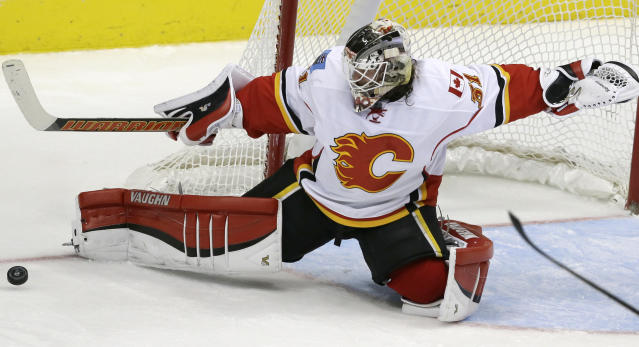 FILE – In this Dec. 17, 2015, file photo, Calgary Flames goalie Karri Ramo (31) deflects a shot during the third period of an NHL hockey game against the Dallas Stars in Dallas. Finland, which has medaled in four of the past five Olympics and has 6-foot-6 Kontinental Hockey League star Mikko Koskinen and longtime NHL goalie Karri Ramo between the pipes. (AP Photo/LM Otero, File)