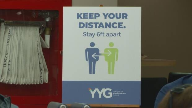 Signs remind travellers at the Charlottetown airport to follow public health protocols.