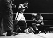 <p>LOS ANGELES – NOVEMBER 15,1962: Cassius Clay (L) knocks down Archie Moore during the fight at the Sports Arena on November 15,1962 in Los Angeles, California. Cassius Clay won by a TKO 4. (Photo by: The Ring Magazine/Getty Images)</p>