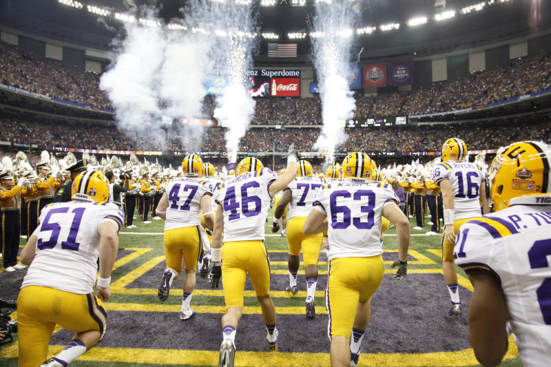 LSU runs onto the field at the Mercedes-Benz Superdome before the 2012 BCS title game against Alabama. (Jamie Schwaberow/NCAA Photos via Getty Images)