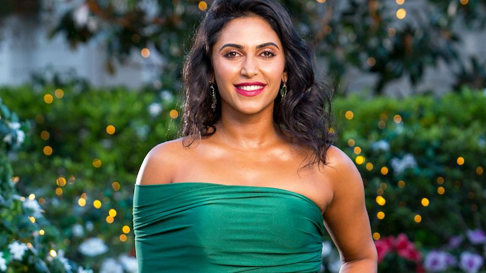 The Bachelor Australia contestant Sogand Mohtat wearing a green off-the-shoulder gown on the show in 2019