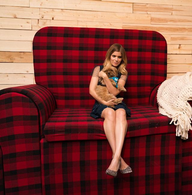 <p>Kate Mara holds one of the dogs up for adoption at the Shopbop NYFW party. (Photo: courtesy of Shopbop) </p>