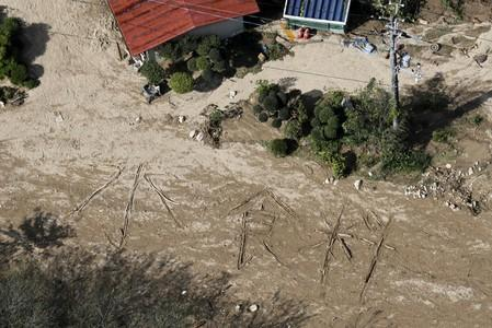 """An aerial view shows the characters for """"water and food"""" written on muddy ground at a flooded area caused by Typhoon Hagibis in Marumori Town"""