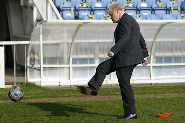 Britain's Prime Minister Boris Johnson practices his skills during a visit to Hartlepool United Football Club as he campaigns on behalf of Conservative Party candidate Jill Mortimer in Hartlepool, north-east England on April 23, 2021, ahead of the 2021 Hartlepool by-election to be held on May 6. (Photo by Ian Forsyth / POOL / AFP) (Photo by IAN FORSYTH/POOL/AFP via Getty Images)