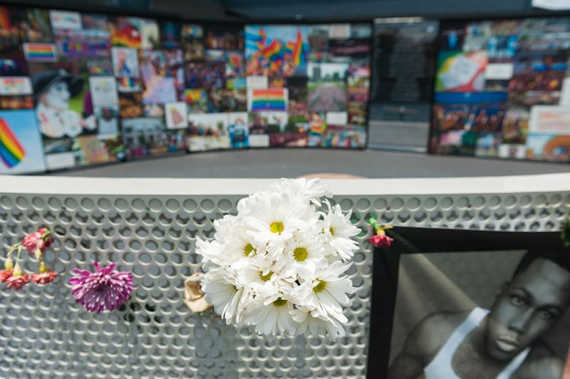 Flowers and signs hang in front of the new interim Pulse nightclub memorial in Orlando, Florida, on June 4, 2018.