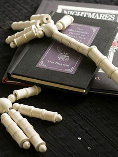 """<p>Need an extra set of hands to finish decorating for Halloween? Make these spooky decorations with some white paint, wooden beads, and twine. </p><p><em><a href=""""https://www.womansday.com/home/crafts-projects/how-to/a3073/halloween-crafts-skeleton-hands-21982/"""" rel=""""nofollow noopener"""" target=""""_blank"""" data-ylk=""""slk:Get the tutorial for Skeleton Hands."""" class=""""link rapid-noclick-resp"""">Get the tutorial for Skeleton Hands.</a></em></p>"""