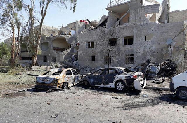 <p>In this photo released by the Syrian official news agency SANA, shows several damaged cars along the road to the airport in southeast Damascus, Syria, Sunday, July 2, 2017. Syrian state TV said Sunday that a series of car bomb explosions have rocked the capital, resulting in multiple casualties. (SANA via AP) </p>