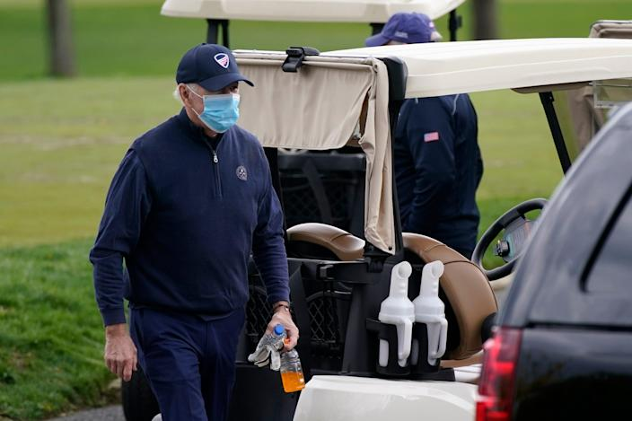 President Joe Biden walks to a motorcade vehicle after golfing at Wilmington Country Club, Saturday, April 17, 2021, in Wilmington, Delaware.