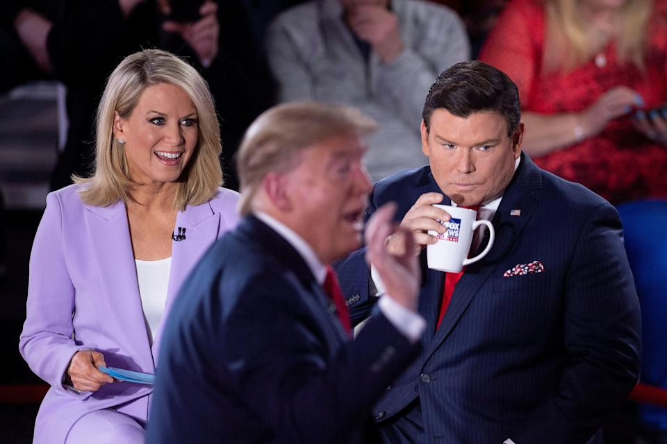 Fox News anchors Martha MacCallum and Bret Baier, pictured in March with Donald Trump, have been asked to quarantine, according to a New York Times report. (BRENDAN SMIALOWSKI via Getty Images)