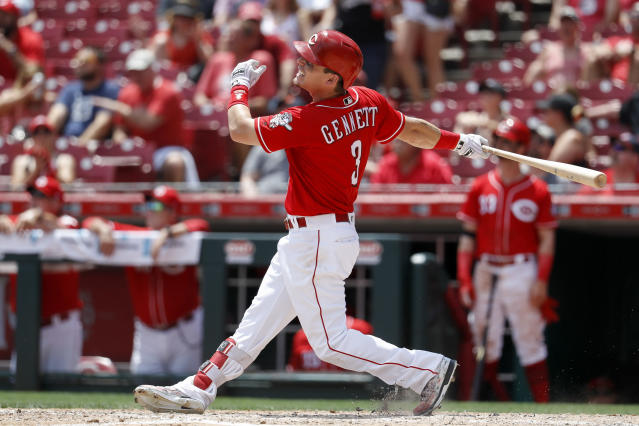 Cincinnati Reds' Scooter Gennett hits a two-run home run off Detroit Tigers starting pitcher Michael Fulmer in the sixth inning of a baseball game, Wednesday, June 20, 2018, in Cincinnati. (AP Photo/John Minchillo)