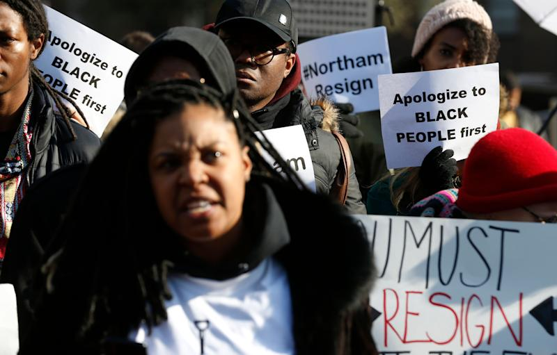 Demonstrators hold signs and chant outside the Governors Mansion at the Capitol in Richmond, Va., Saturday, Feb. 2, 2019.
