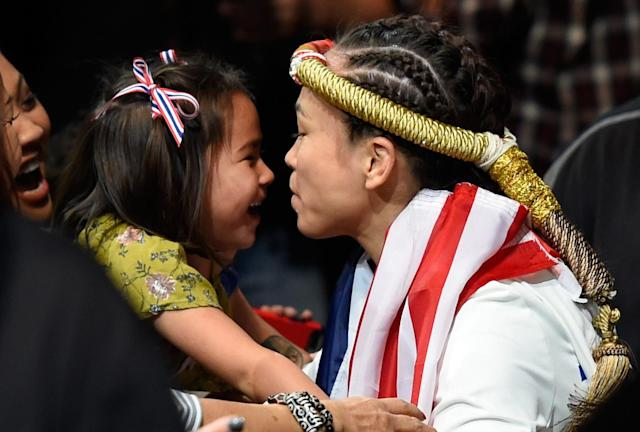 Michelle Waterson kisses her daughter, Araya, before entering the Octagon during the UFC Fight Night event at Sprint Center on April 15, 2017 in Kansas City, Missouri. (Getty Images)