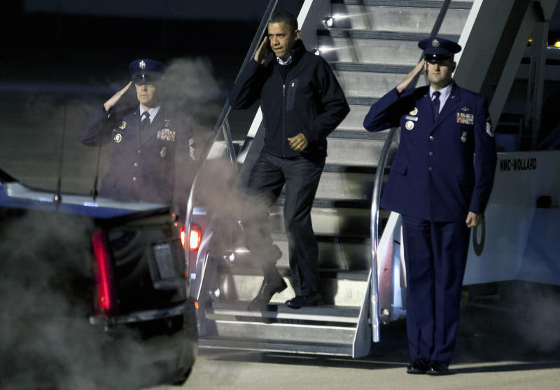 President Barack Obama salutes as he deplanes Air Force One on his early-morning arrival in Madison, Wis., Monday, Nov. 5, 2012. (AP Photo/Andy Manis)