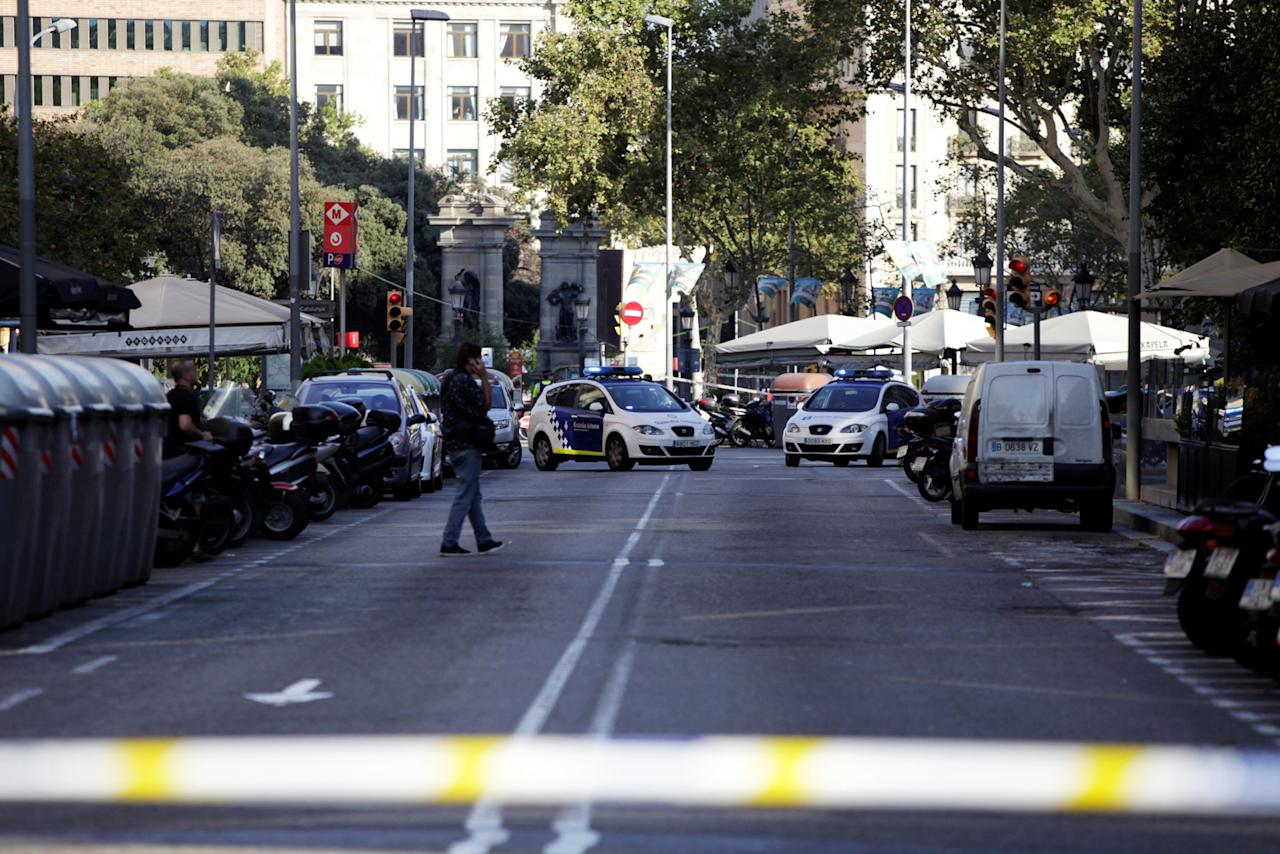 <p>A street is cordoned off after a van crashed into pedestrians near the Las Ramblas avenue in central Barcelona, Spain August 17, 2017. (REUTERS/Stringer) </p>