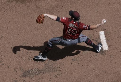 Arizona Diamondbacks starting pitcher Zack Godley throws during the first inning of a baseball game against the Milwaukee Brewers Wednesday, May 23, 2018, in Milwaukee. (AP Photo/Morry Gash)