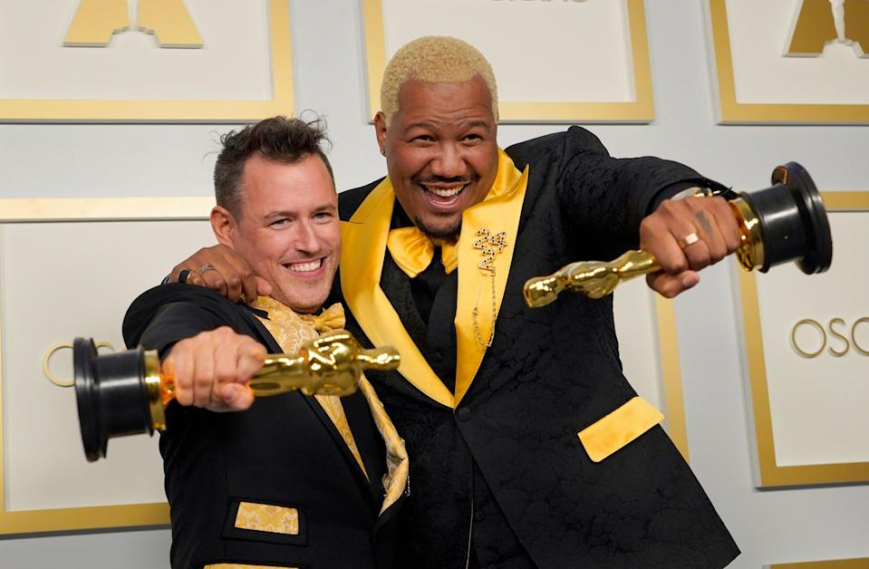 Martin Desmond Roe, and Travon Free pose with award for Best Live Action Short Film for 'Two Distant Strangers'AP