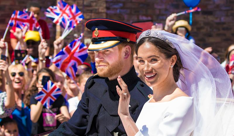 Prince Harry and Meghan Markle, Duke and Duchess of Sussex, during the Carriage Procession of their wedding in Windsor, Berkshire, UK. (Photo by DPPA/Sipa USA)