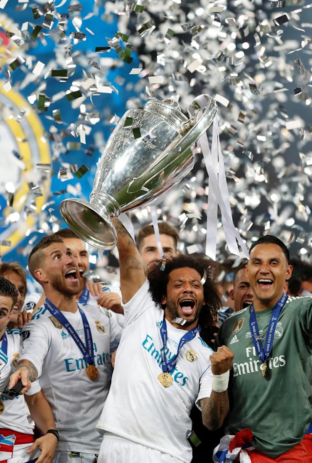 Soccer Football - Champions League Final - Real Madrid v Liverpool - NSC Olympic Stadium, Kiev, Ukraine - May 26, 2018 Real Madrid's Marcelo lifts the trophy as they celebrate winning the Champions League REUTERS/Andrew Boyers