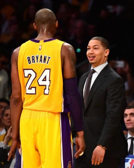 Lakers star Kobe Bryant and Cavaliers coach Tyronn Lue exchange greeting during a game in 2016.