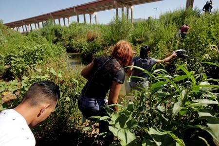 FILE PHOTO: Migrants from Cuba are seen on the banks of the Rio Bravo river as they cross illegally into the United States to turn themselves in to request asylum in El Paso, Texas, as seen from Ciudad Juarez