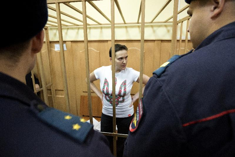 Nadiya Savchenko stands inside the defendant's cage during a hearing in the Basmanny district court in Moscow on November 7, 2014 (AFP Photo/Kirill Zykov)